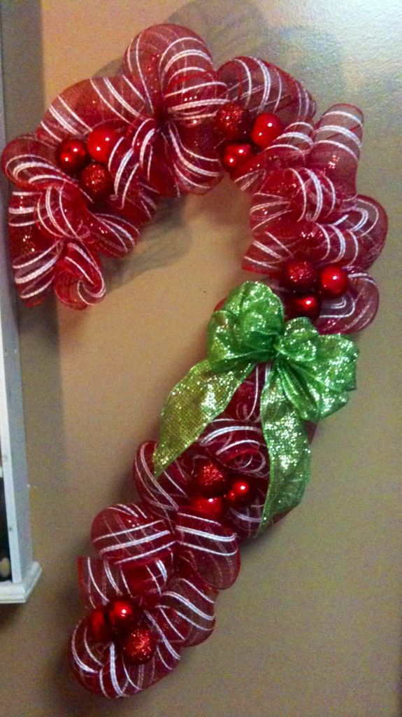 "Candy cane wreath made with a wire hanger and one roll of 5 1/2"" mesh"