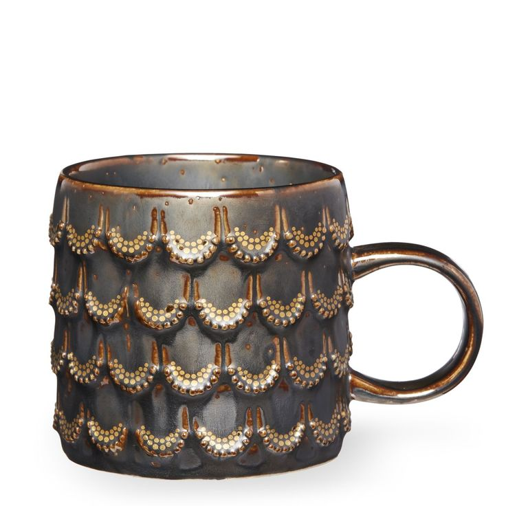 An Anniversary Collection mug inspired by our Siren's tail, featuring a grey reactive glaze and gold details.