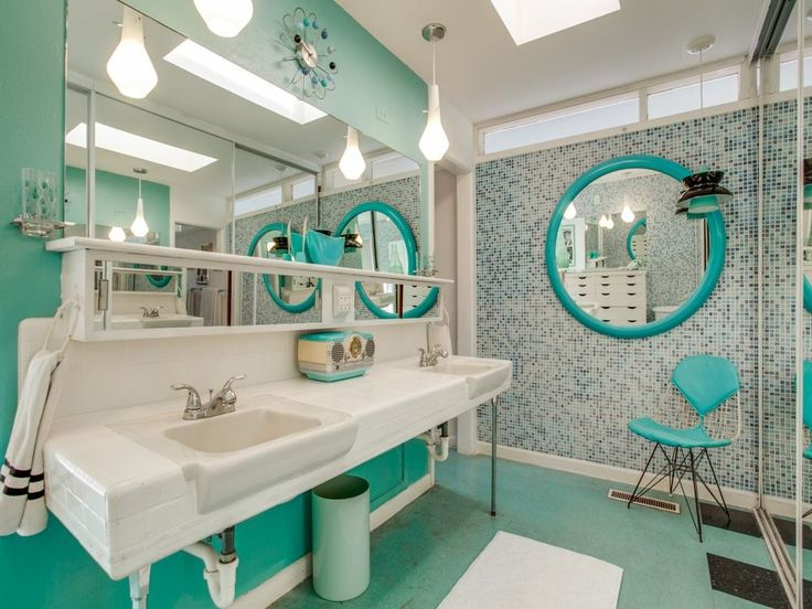 But then the color comes rushing back in the master bath with soothing turquoise. Hi, I see you, adorable vintage radio that matches perfectly.