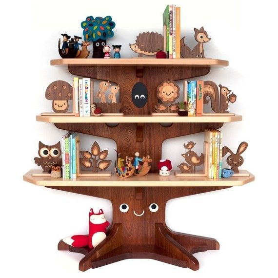 I absolutely positively love this.  This is incredible.   Happy Tree Bookshelf : by graphicspaceswood : etsy
