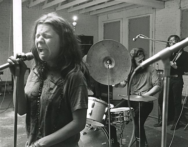 Janis at work during rehearsal.  Dave Getz on drums and Sam Andrew on guitar in the back.