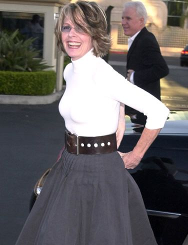 Diane Keaton.  LOVE HER!!! Her style is so clean and simple.  No one can work a starched white shirt like her.  La De Da!