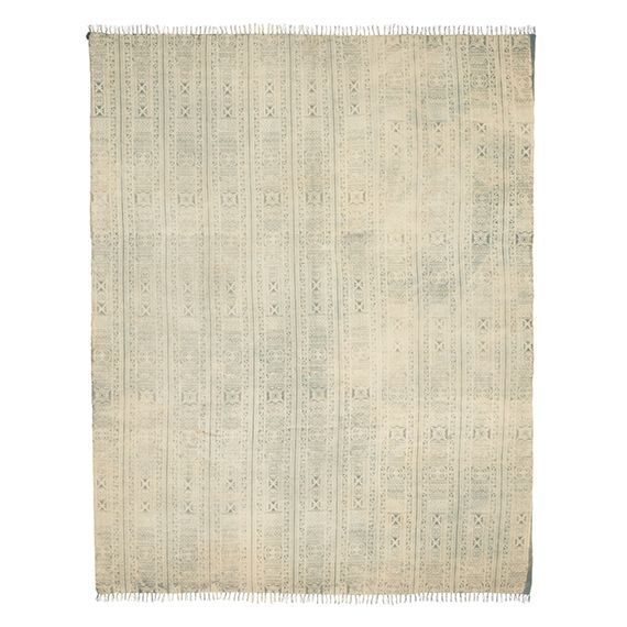 A deliberately faded, hand-woven 100% cotton rug, featuring a delicate printed pattern and fringed ends, ideal to place under one of our coffee tables and giving your sitting room and touch of warmth.