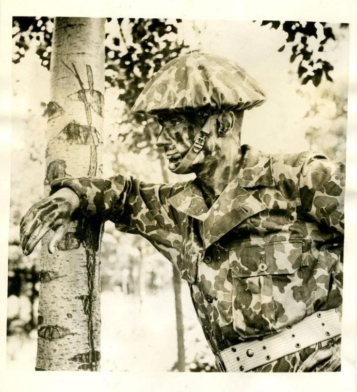 A completely camouflaged Commonwealth soldier early in World War II
