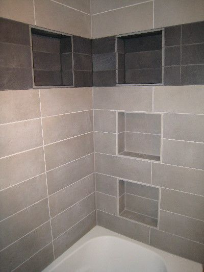 Great shower storage, shelving recessed into the wall
