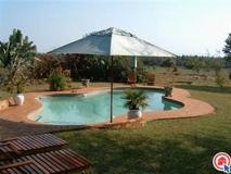 Hluhluwe 13.5  21h Sand Forest Lodge is situated on a nature reserve on the edge of an ancient sand forest and lies 1.5km west of St Lucia Wetlands Park. The Lodge is a 20 minutes from the Hluhluwe/iMfolozi Game Reserve. Sand Forest Lodge is an ideal base in close proximity to many local attractions including St Lucia, Sodwana Bay. Facilities include the Marula Tree Bar and restaurant, swimming pool, boma and sand forest bird and tree trail