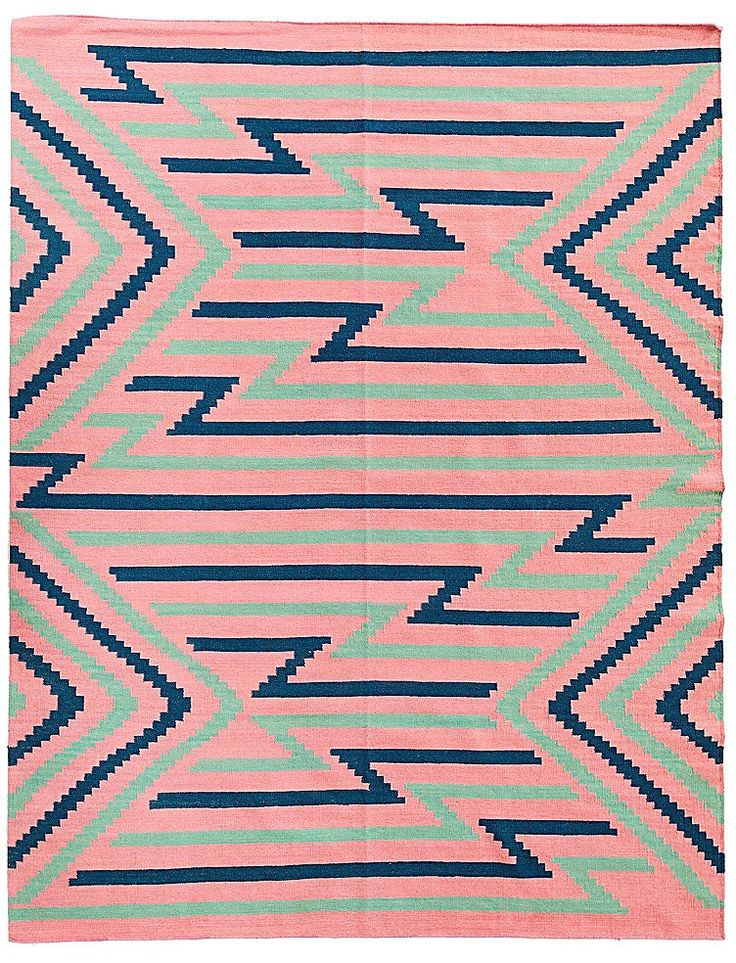 Innovative sharp zig-zags transverse the colorful Jaeda rug, a creative addition for a trend-setting space.