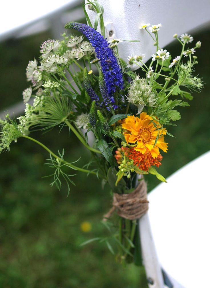 Orange and yellow wildflower centerpiece See more