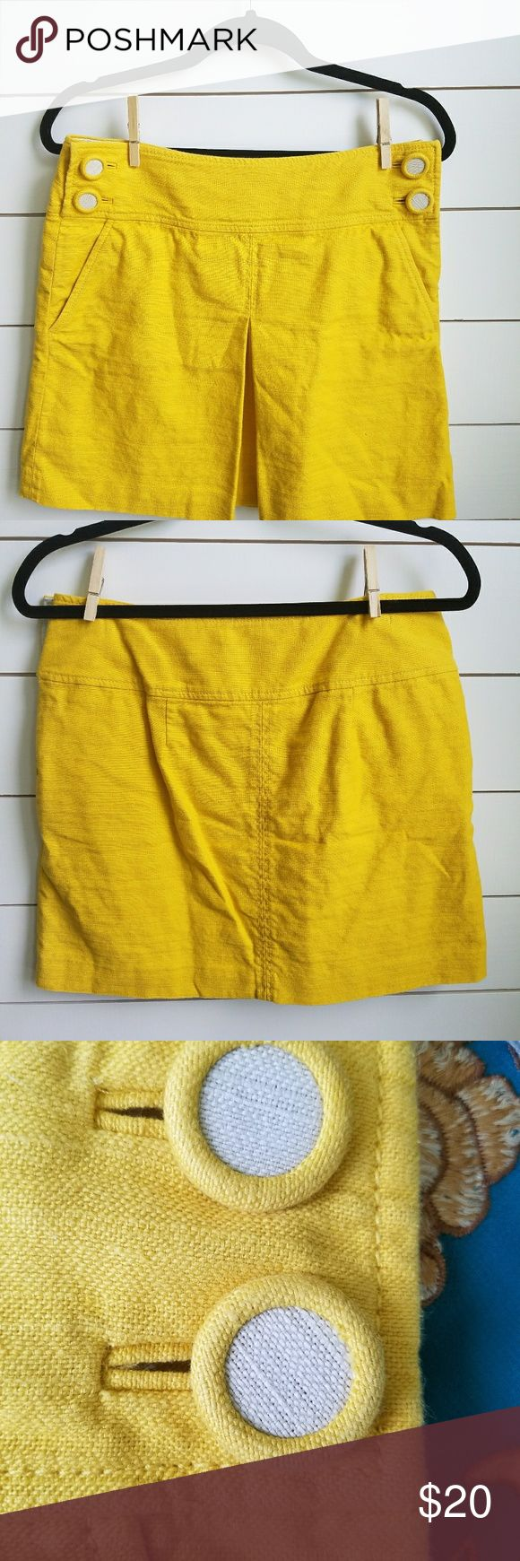 Jcrew mustard yellow skirt Mustard yellow skirt with cute bottons near waist. Fabric has a vertical pleats in from of skirt and has pockets on both sides. J. Crew Skirts A-Line or Full