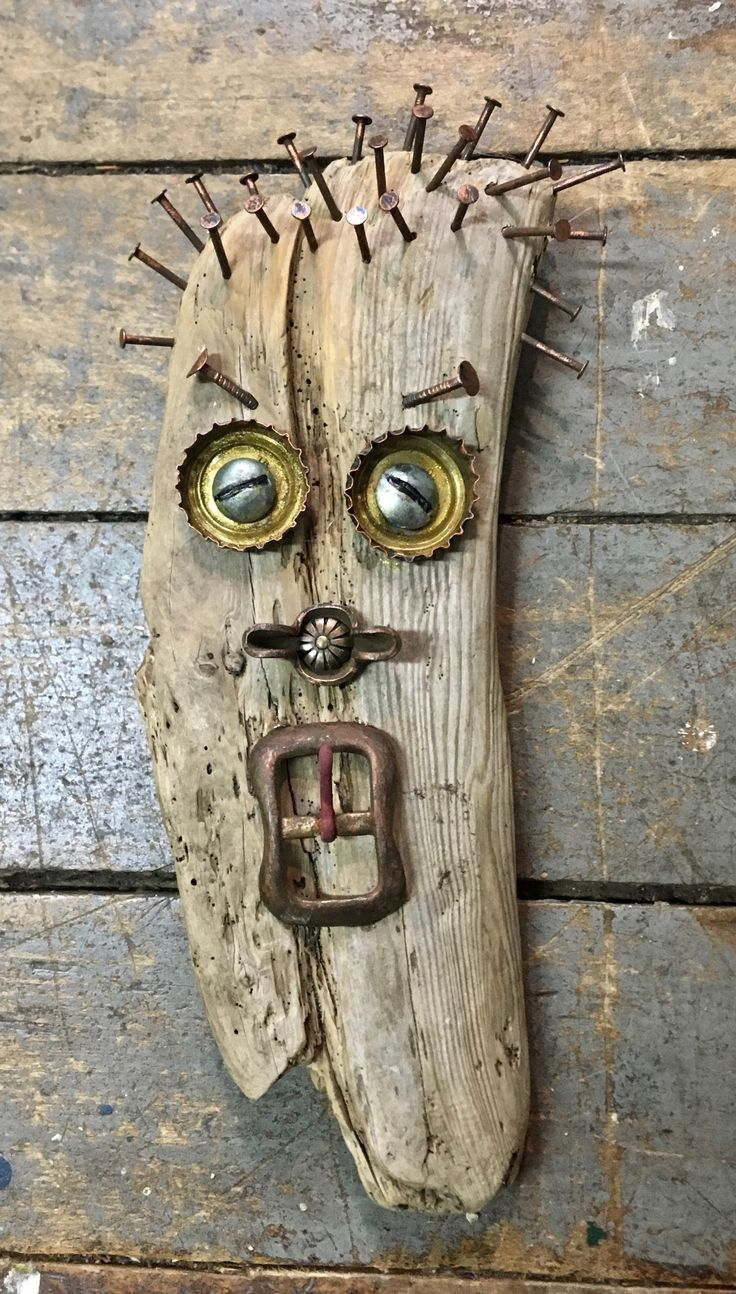 Driftwood mask with found objects