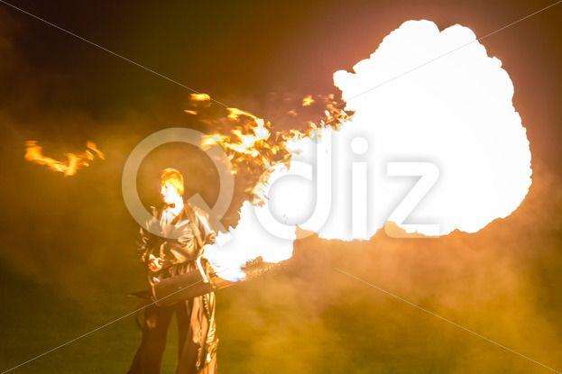 Qdiz Stock Images Fire show,  #action #artist #blaze #blazing #bonfire #burn #burning #danger #demolished #editorial #effect #energy #exploding #explosion #fiery #fire #firebrand #fireshow #firewall #flame #flamethrower #flametongue #flammable #furious #glowing #guitar #heat #hellfire #hot #ignite #illuminated #illustrative #inferno #light #male #man #motion #night #people #perfomance #power #projector #show #smoke #spitfire #swirl #warm #wildfire #yellow