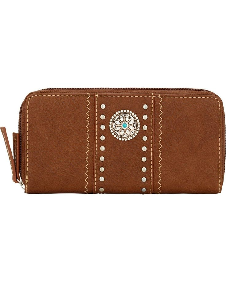American West Women's Bandana Rio Rancho Wallet Brown One Size. Man-Made Leather Construction. Silver spot accents with silver concho. Zip-around closure.
