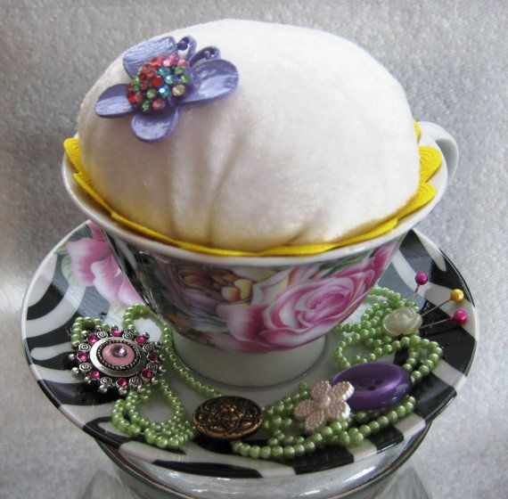 Tea Cup Pin Cushion by mycreativeclutter on Etsy, $10.00    What a cute idea! I bet my Mum would love one of these!!