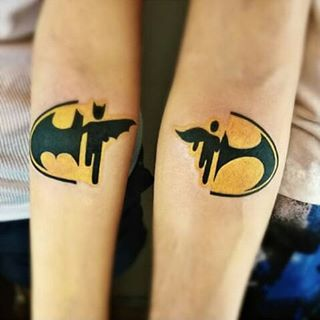 And this Batman and Nightwing rockin' duo.   23 Geeky Couple Tattoos That Are Beyond Perfect