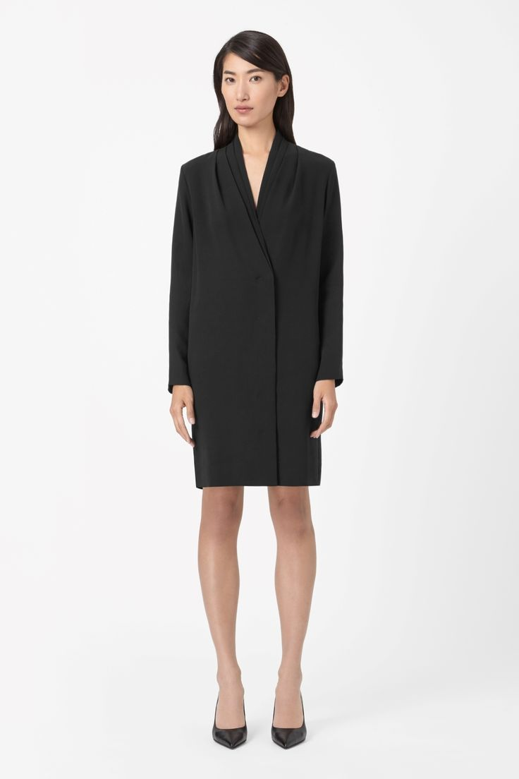 Made from unlined silk with a fluid quality, this dress has a deep v-neckline with a pleated shawl collar. A loose straight shape, it has neat long sleeves, in-seam pockets and a hidden button fastening along the front.