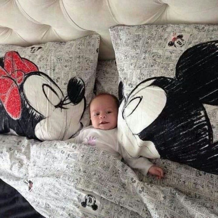 Cute, happy baby, along with Minnie & Mickey Mouse