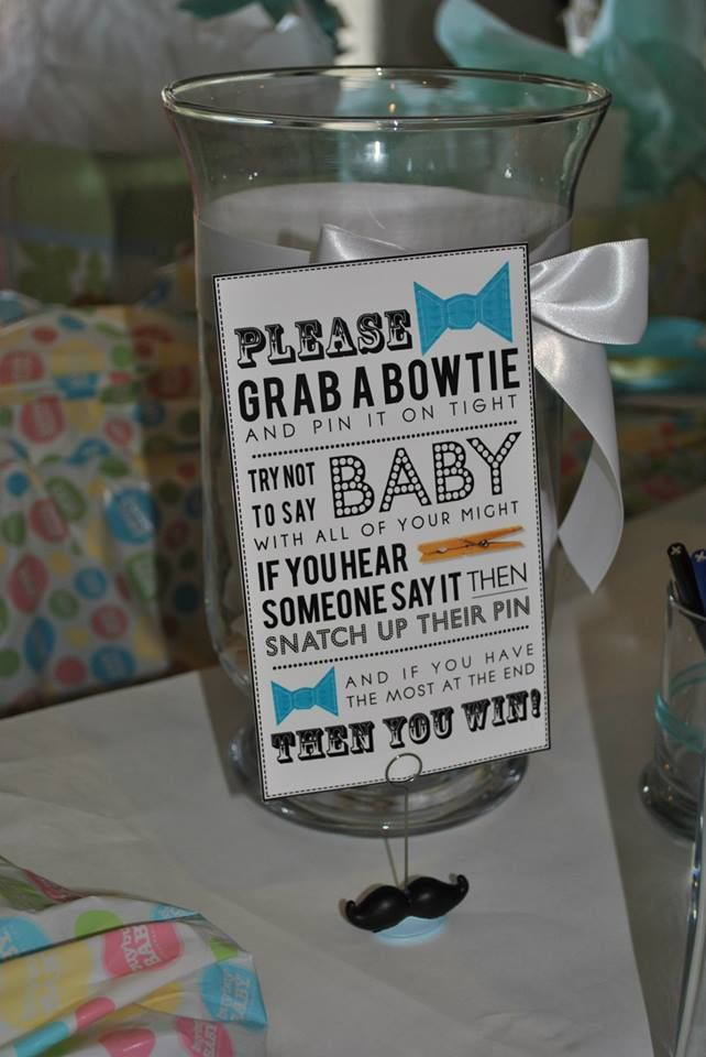 Bowtie Baby Shower game can be done for boys and girls! sign available for both.  Decor jar filled with Bowties on clothespins.