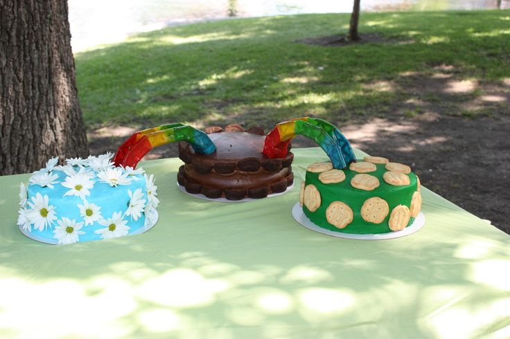 Cakes for joint bridging ceremony...Daisy (real daisies) to Brownie (brownie bites) to Juniors (Trefoils). Bridges are plastic cake decorations wrapped with Fruit Roll-ups.