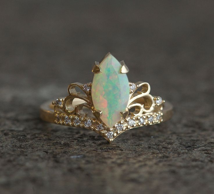 Beautiful vintage inspired opal and diamond ring. Avaliable in 14 and 18k gold, platinum. Other stones are also available: morganite, pearl, turquoise, diamond, rose cut diamond, black diamond, aquamarine and many more. Please contact us for the pricing info. Please choose ring size and metal at the drop down menu. Larger sizes than 8 available upon request. Product info: - 14k/18k solid - main stone welo opal 10 x 5mm, stone size can be customized, larger stones available - diamonds - t...