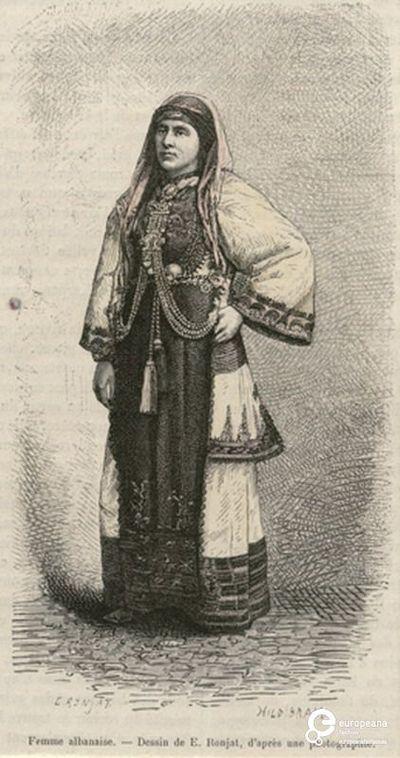 """Γυναίκα με τοπική ενδυμασία Λιβαδειάς. Επιγραφή: """"Femme albanaise-Dessin de E.Ronjat d'après une photographie"""". Υπογραφές: """"E.RONJAT"""", """"HILDIBRAND"""". Από το περιοδικό """"Le Tour du Monde"""", Paris 1884, τευχ. XLVII, σελ. 237. Δημιουργός: Le Tour du Monde. Ημερομηνία Δημιουργίας: 1884. Συλλέκτης: Peloponnesian Folklore Foundation Ίδρυμα: Europeana Fashion. Συλλέκτης: Peloponnesian Folklore Foundation Ίδρυμα: Europeana Fashion"""