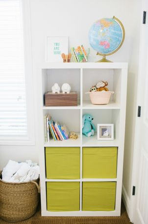 A cute way to organize everything in a baby nursery? CLICK for more pictures of the whole room! http://thestir.cafemom.com/baby/165565/rainbow_colors_pop_in_simple?utm_medium=sm&utm_source=pinterest&utm_content=thestir