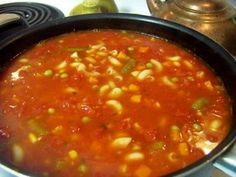 Cracker Barrel Vegetable Soup:  1 gallon water  20 oz frozen corn  20 oz frozen green peas  20 oz frozen baby lima beans  14 oz tomato juice  1 lb. idaho baking potatoes, peeled and diced  1 lb. canned green beans, drained  6 1/2 c. diced tomatoes  5 oz beef base (not bullion)  4 oz chopped onion  4 oz chopped celery  1 oz frozen diced green papers    1. Put all ingredients in pot and cook covered at  a rapid simmer for 1/2 hour.  2.Uncover and cook at rapid simmer again for 1/2 hour more.