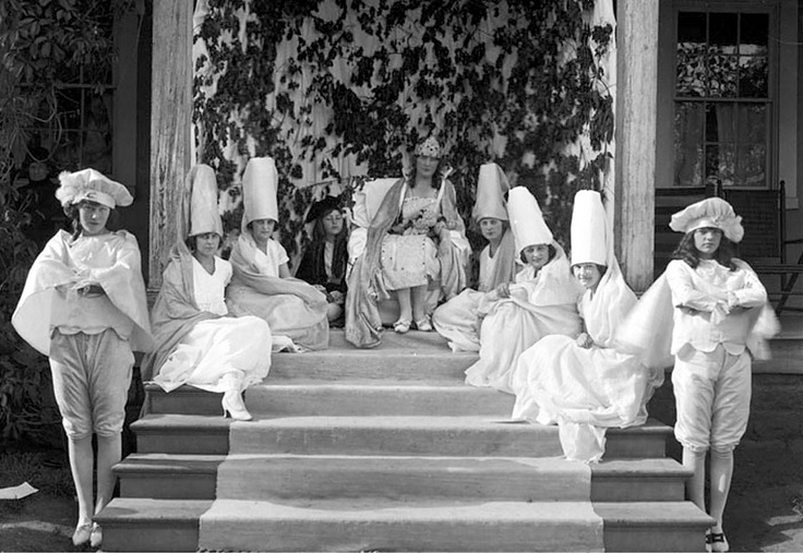 Girls in costume posing for a photograph on the steps of Rowland Hall in 1921. Courtesy Utah State Historical Society