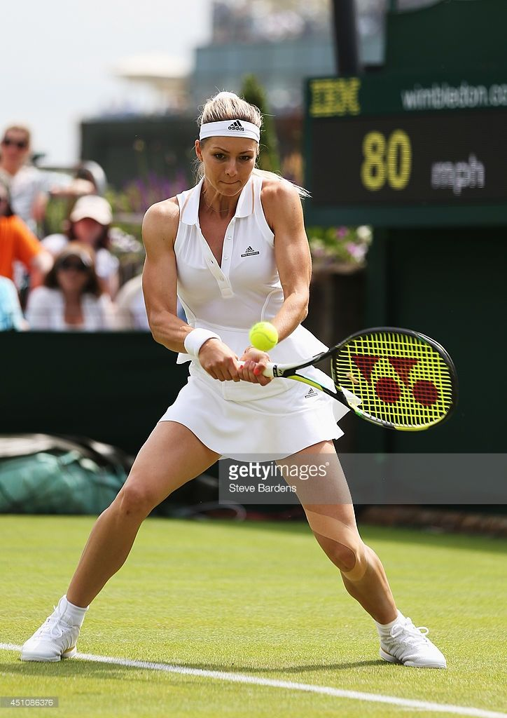 Maria Kirilenko of Russia plays a backhand during her Ladies' Singles first round match against Sloane Stephens of the United States on day one of the Wimbledon Lawn Tennis Championships at the All England Lawn Tennis and Croquet Club at Wimbledon on June 23, 2014 in London, England.