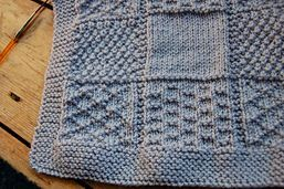 I like the idea of knitting this so it looks like squares of different stitch patterns but without the sewing up.