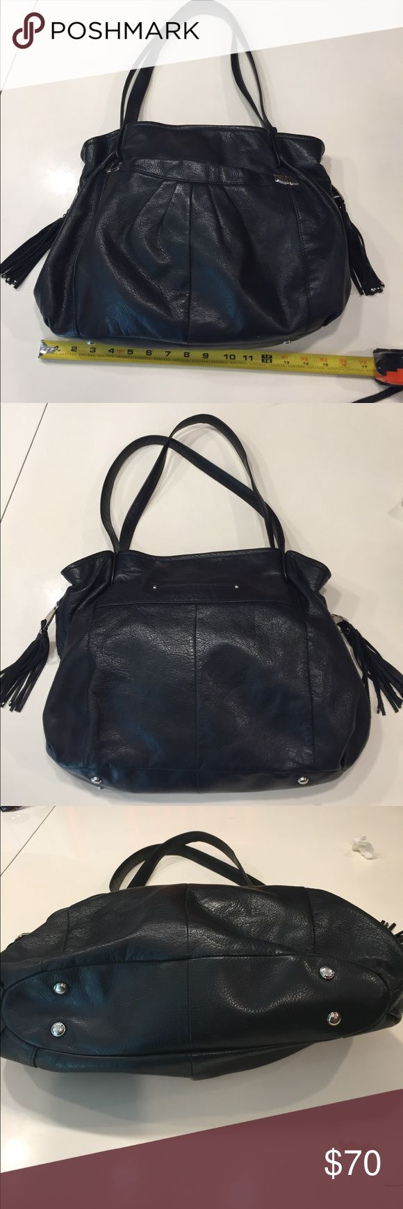 Black B. Makowsky handbag with tassels Black B. Makowsky handbag with silver metal details and tassels on the sides. If you like pockets, this bag is for you! 1 on the front with a magnetic closure. 1 on each side with a zip closure. 1 small open pocket on the back plus 3 on the inside. The interior has a zippered divider with a leopard print lining. Minor wear on the bag but still in very good condition. b. makowsky Bags Shoulder Bags