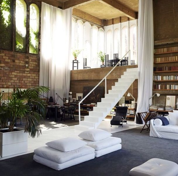 Even though the dining area gives me vertigo (where is the railing?!), this loft space is spectacular. Love the window too.