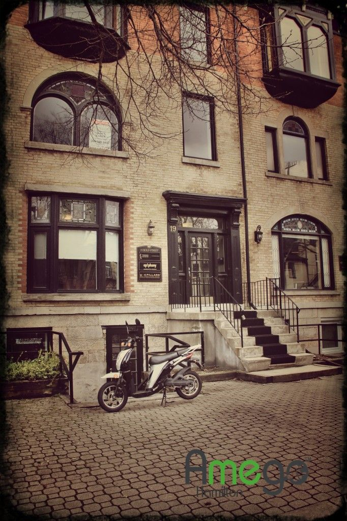 Amego Hamilton electric vehicles new place of belonging, a beautiful, historic, Hamilton, Ontario building. #HamOnt #storefront #electric #ebikes