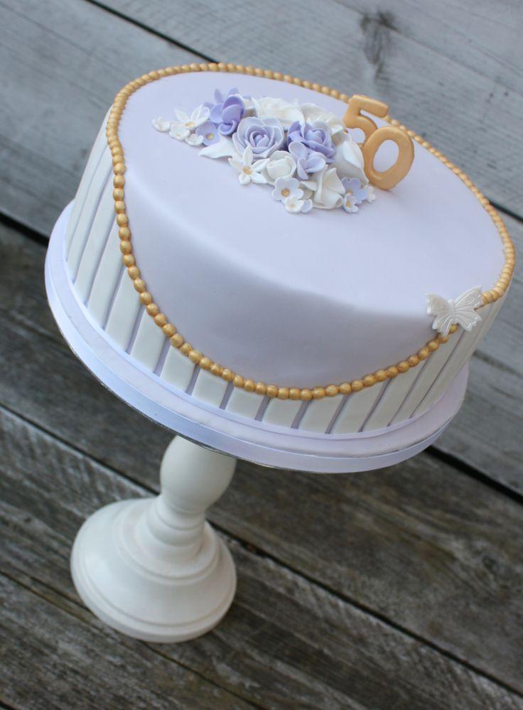Purple and white Birthday cake
