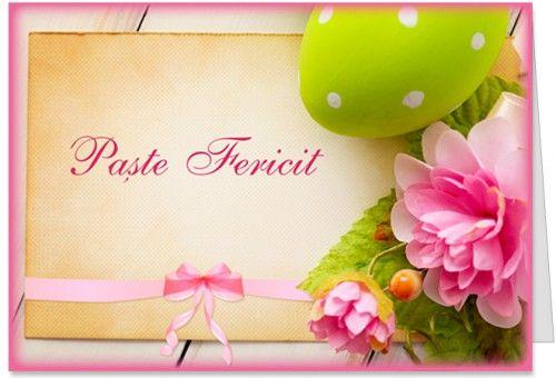 Urare de Paste Fericit Felicitare de Paste al carei mesaj Paste Fericit Numele ei/lui! apare pe un carton cu funda roz, cu oua de Paste si flori.