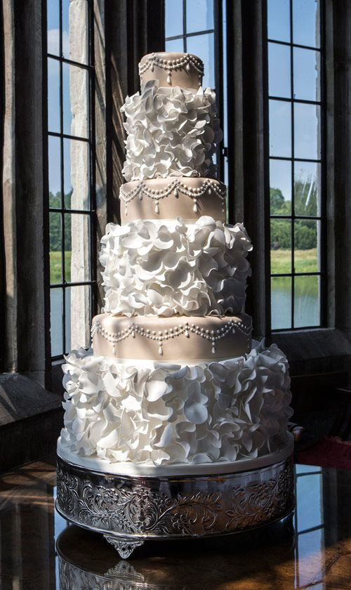white and latte wedding cake .. I would add rhinestones to the chandelier layer of the cake
