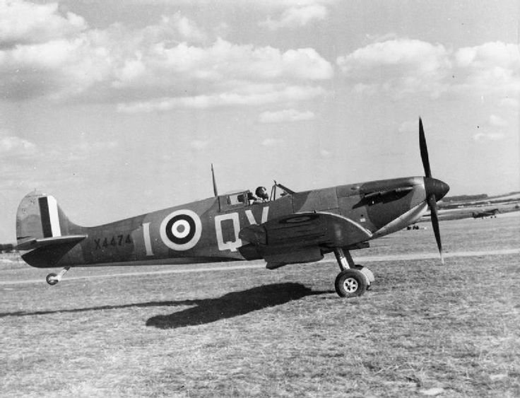 Spitfire Mark IA, X4474 'QV-I', of No. 19 Squadron RAF, taking off from Fowlmere, Cambridgeshire, with Sergeant B J Jennings at the controls.