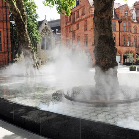 Clouds of mist erupt from the base of two trees in this London water feature designed by Japanese architect Tadao Ando. The trees sit in a raised granite-edged pool in front of the Connaught Hotel in Mayfair. Atomisers hidden at the base of the trees create clouds of water vapour for fifteen seconds every fifteen minutes. Photo: Adrian Brookes http://www.tadao-ando.com/