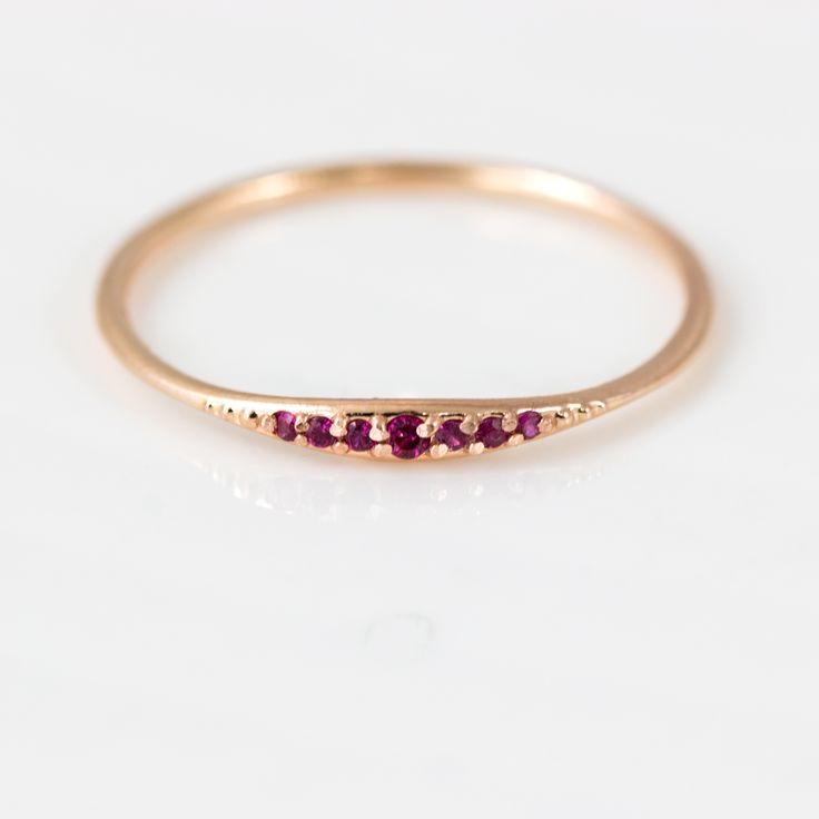 This delicate little ruby ring would make a great addition to any stacking ring set.  This piece is simple and sweet, and can be customized in your choice of 14k gold metal color and finish.  Overview