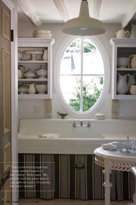Home of Hallmark stylist Andy Newcom. I love how he added the large  oval window making the vintage sink  and ironstone seem more regal.