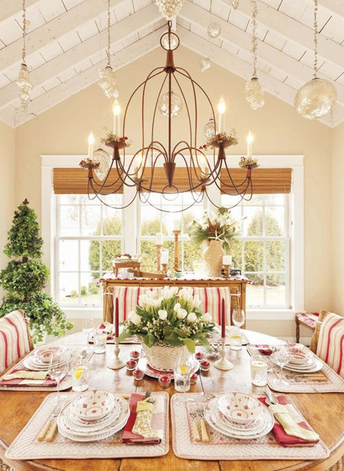 French Country Kitchen. Red and white for a fun and festive look. The delicate chandelier completes the room.