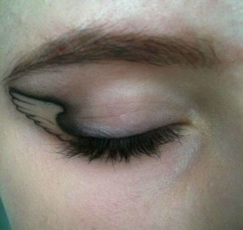 A whole new meaning to winged eye liner. - that's just neat... would be a great tattoo