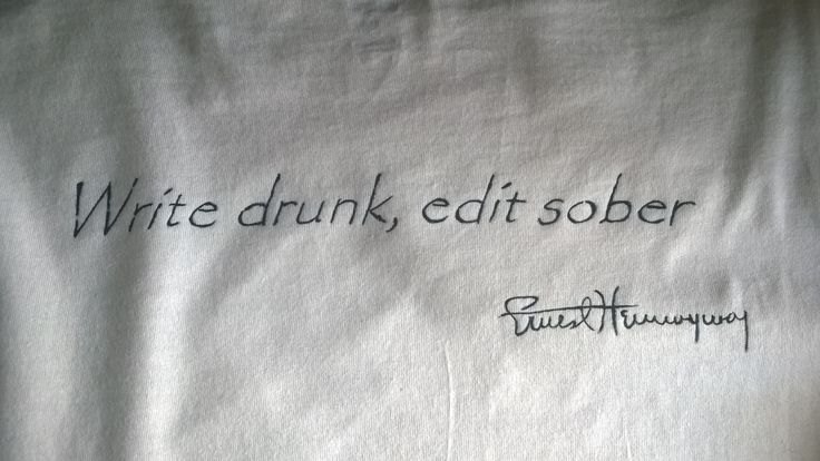 The back of the Hemingway shirt. I paint the phrase and the writer's firm. Color on cotton