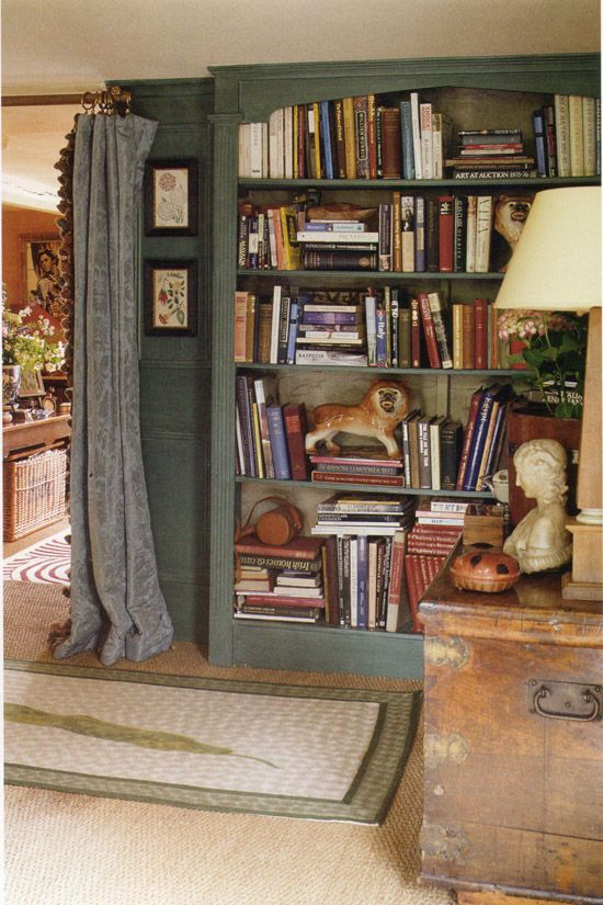 Study: the informal stacking of books with fantastic little sculptures next to the formal quality drapes.