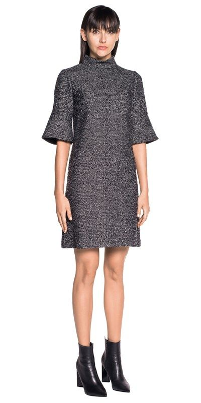 Made from European tweed fabric, this shift dress features a stand collar and three-quarter length sleeves with flared cuffs. Fully lined. Fastened with a metal zip back. Made in Australia.
