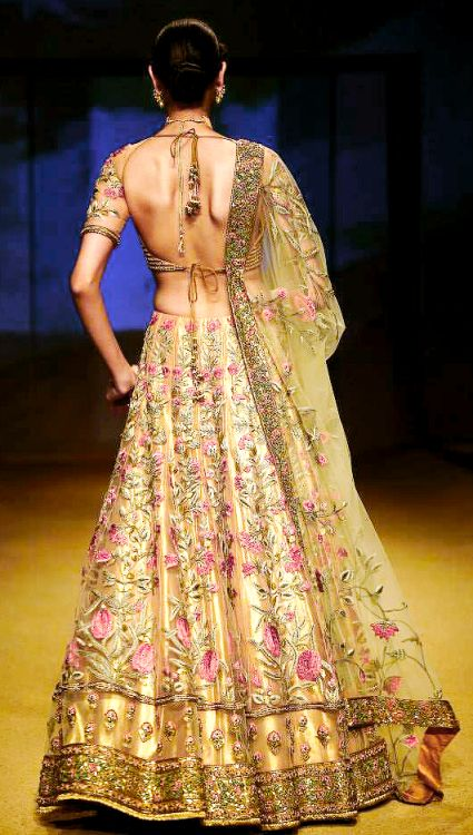 Gorgeous gold lehenga with pink floral net overlay