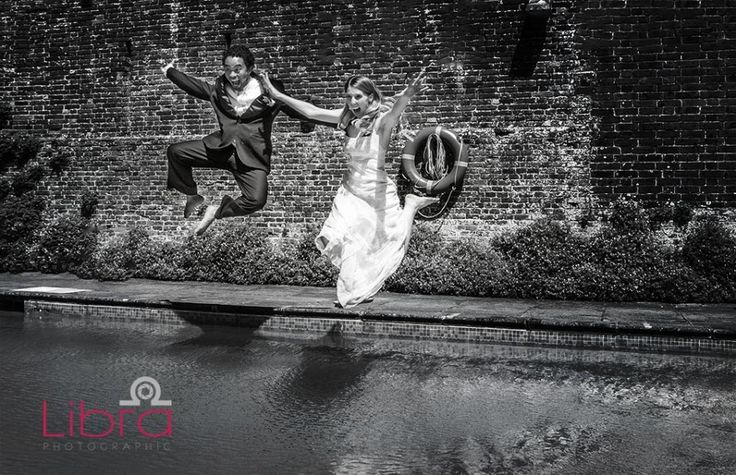 Bride and Groom jump into a swimming pool