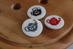 cross stitched tea pot badge party favours