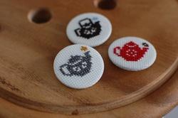cross stitched tea pot badge party favours
