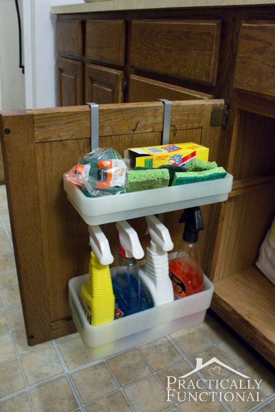 Kitchen Tour: Utilize the inside of your cabinet doors for storage, hang over the door to have a towel bar on other side.  From bed bath and beyond.