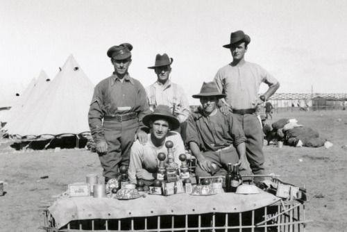 """A Merry Christmas in Egypt 1915.  A group of Australian soldiers with the Christmas lunch laid out on a makeshift table in 1915.  The negative for this photo of a group of soldiers with their Christmas lunch was one of 89 found in a """"Welcome Nugget"""" tobacco tin on the body of Gunner Maurice Charles Thompson, who served in Egypt, Belgium and France. He took his photographs using a Kodak Vest Pocket Autographic camera but died in France on April 29, 1918.  abc.net.au"""
